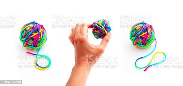 Hand holding a colorful threat in a ball of yarn isolated on white picture id1160147395?b=1&k=6&m=1160147395&s=612x612&h=xqfx9bzl4w6eedqsh3fbz4an2bgdtgnf05eibatwwvk=