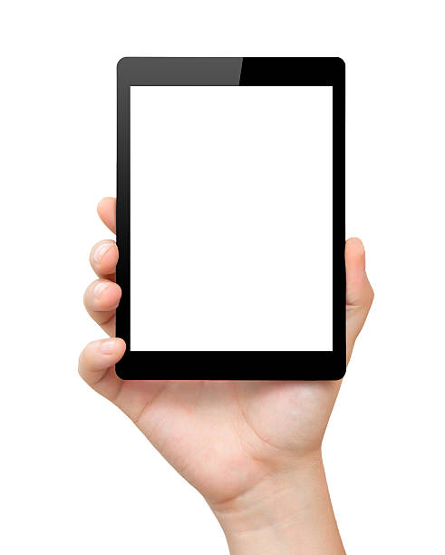 A hand holding a computer tablet with a white screen stock photo