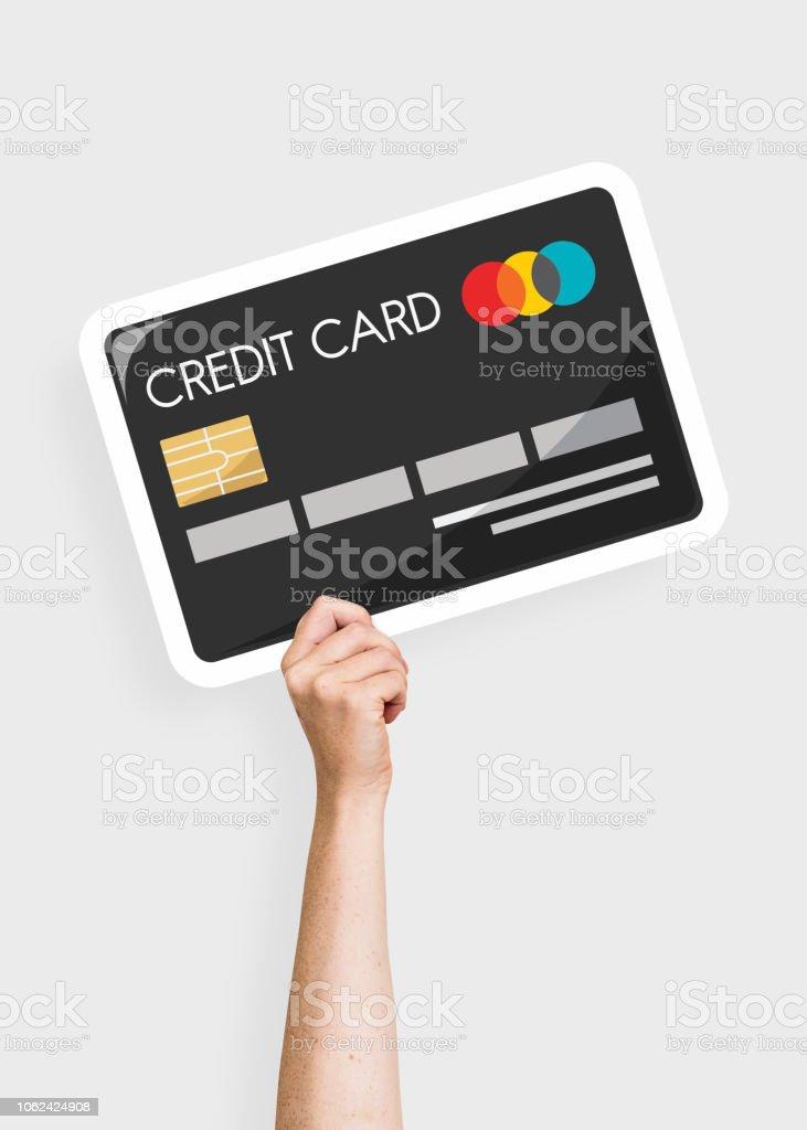 Mão segurando um suporte de cartão de cartão de crédito - foto de acervo