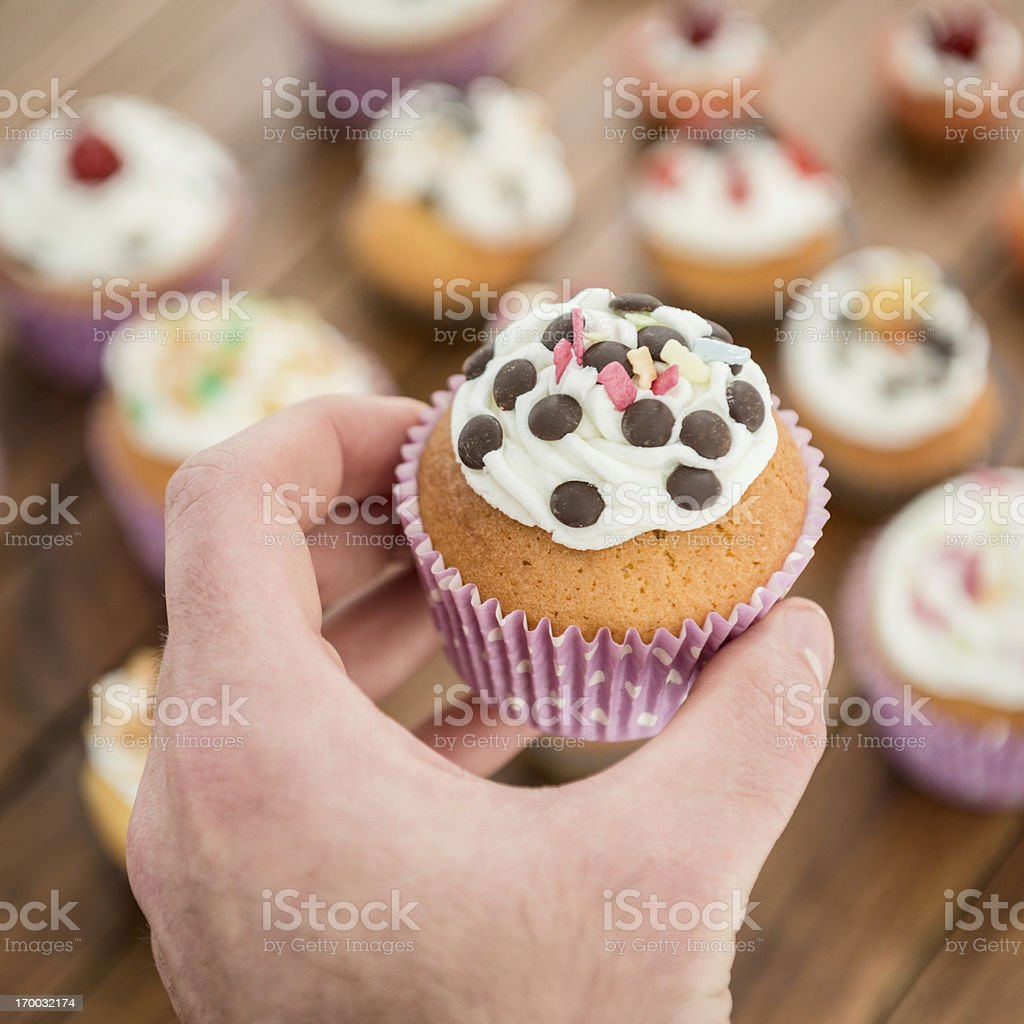 Hand holding a Cupcake royalty-free stock photo