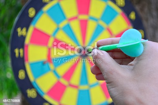 istock Hand holding a dart getting ready 484276868