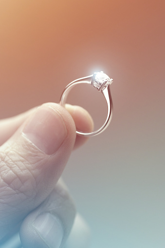 Hand Holding A Diamond Engagement Ring Stock Photo Download Image Now Istock