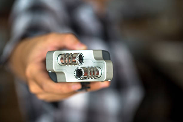 hand holding a digital recorder - dictaphone stock pictures, royalty-free photos & images