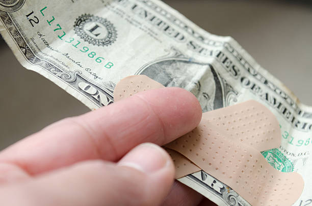 Hand holding a dollar bill stock photo