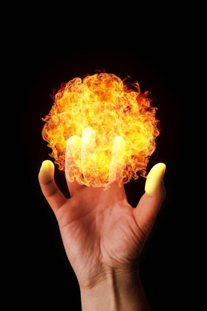 Hand holding a fireball stock photo