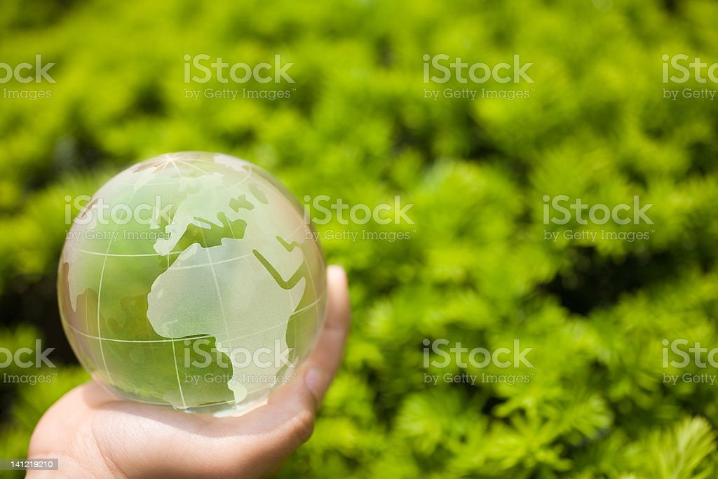 Hand holding a glass globe royalty-free stock photo
