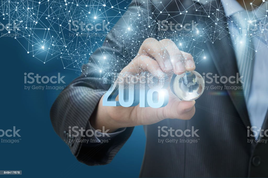 Hand holding a globe on a background 2018. stock photo