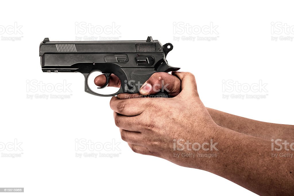 Hand holding a gun isolated on white background stock photo