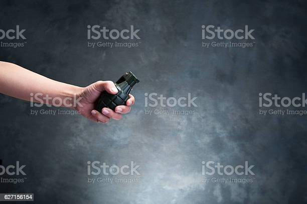 Hand holding a hand grenade