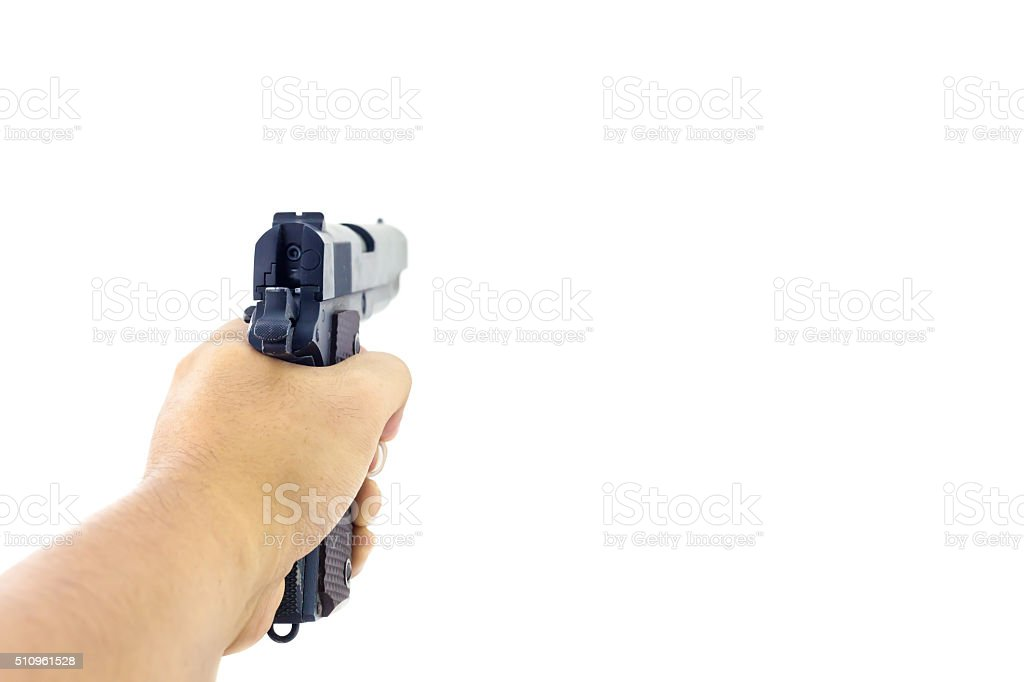 Hand holding a handgun. stock photo