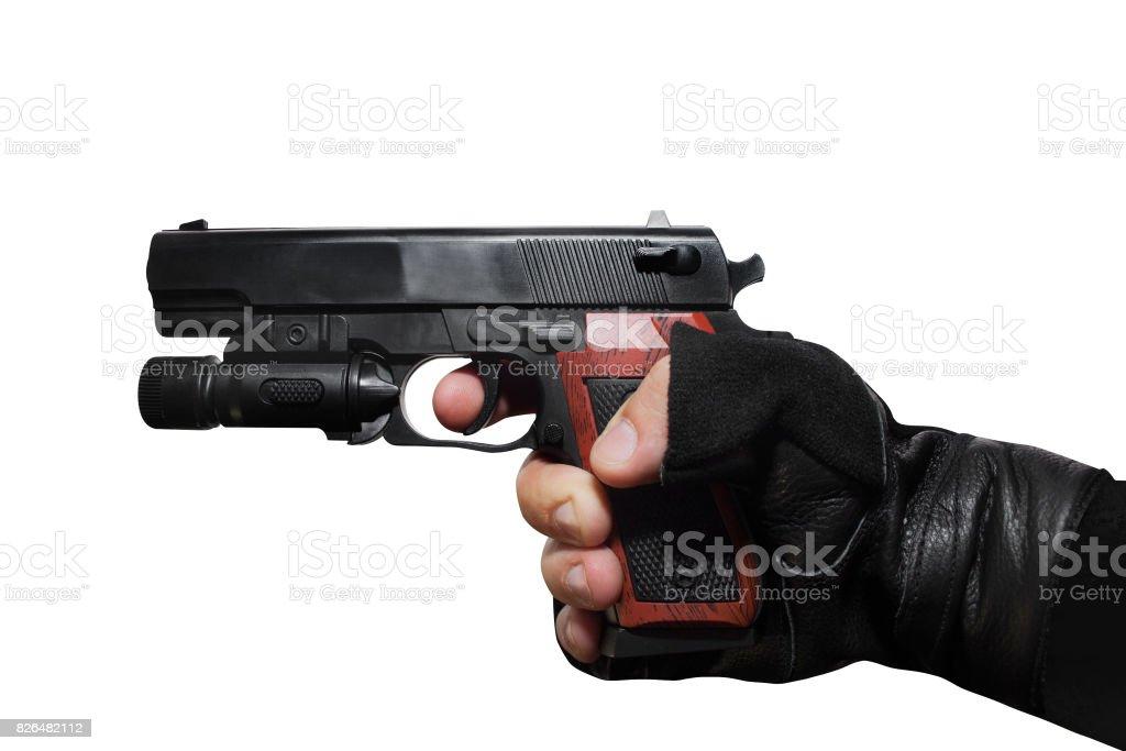 Hand holding a handgun profile. stock photo