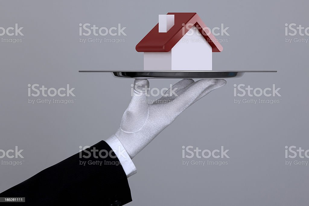 Hand Holding A House In Tray With Clipping Path stock photo