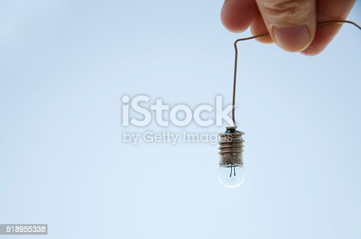 istock hand holding a light bulb 518955338