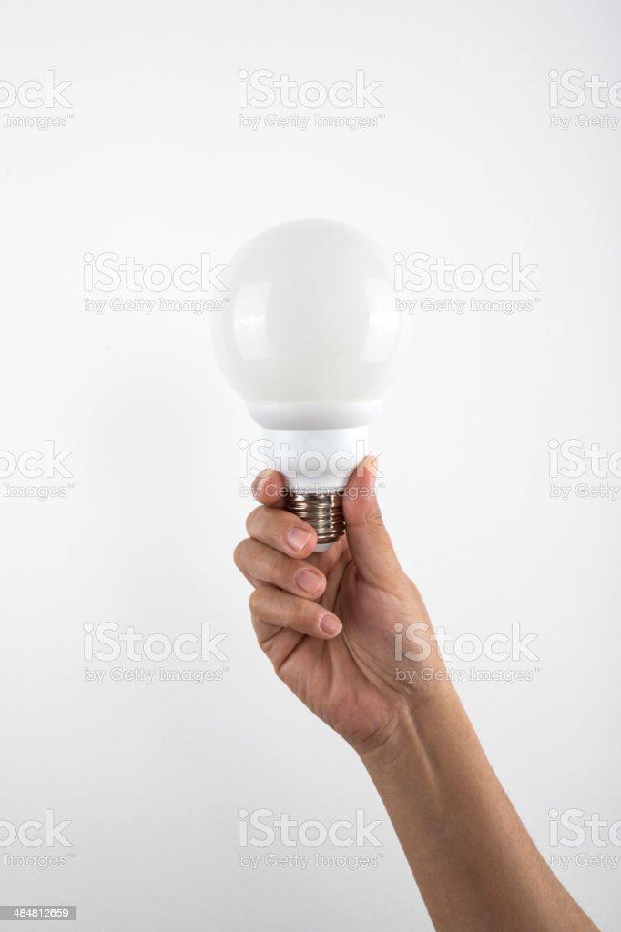 Hand Holding a Lightbulb royalty-free stock photo