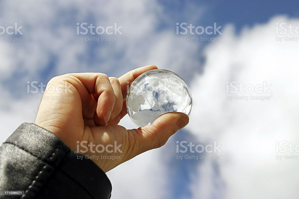 Hand holding a little transparent globe royalty-free stock photo