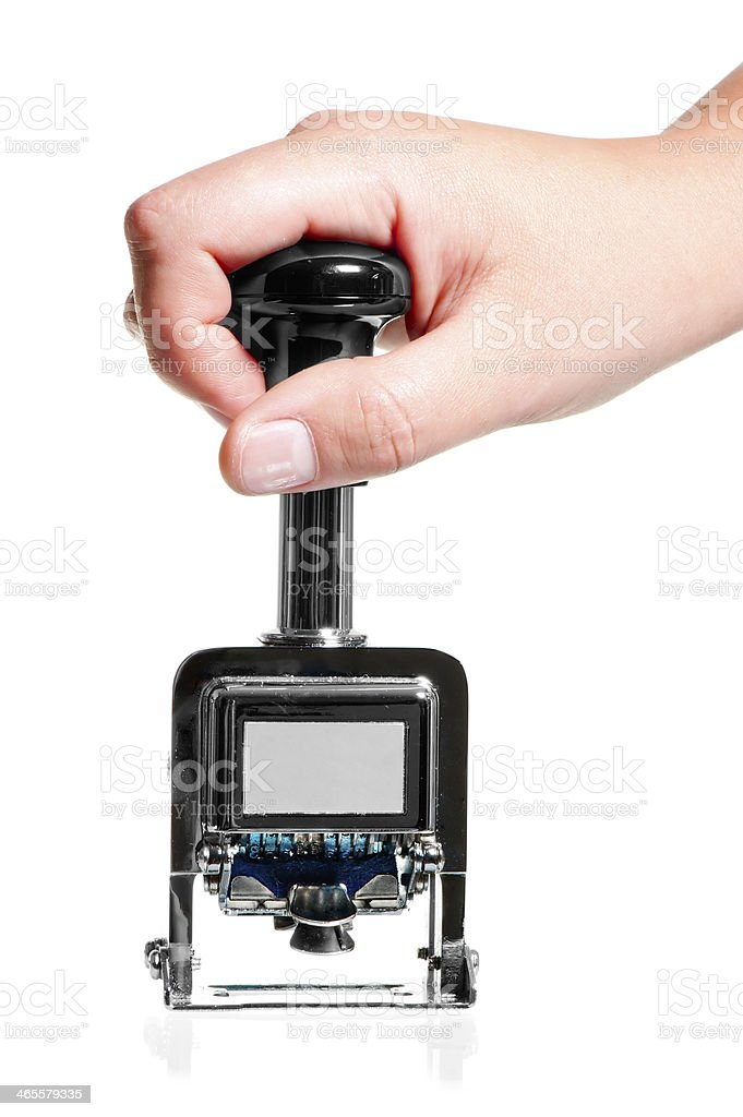 hand holding a metal seal with the date handle royalty-free stock photo