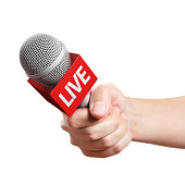 istock Hand holding a microphone 1148980257