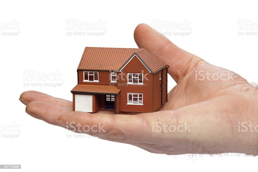 Hand holding a miniature house royalty-free stock photo