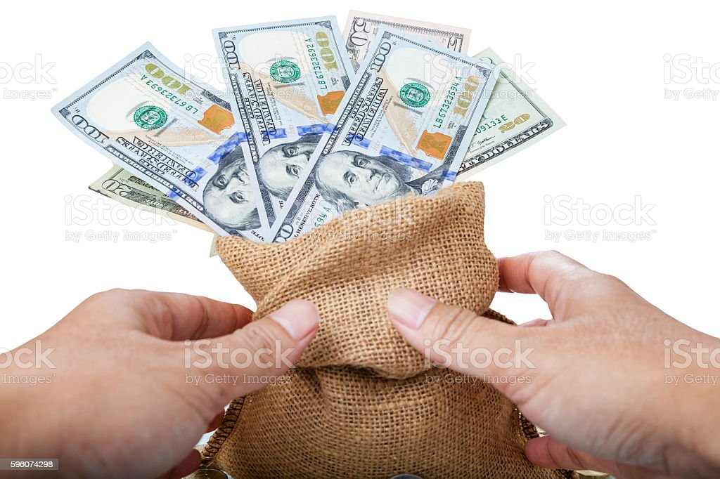 Hand holding a money bag with US dollar royalty-free stock photo