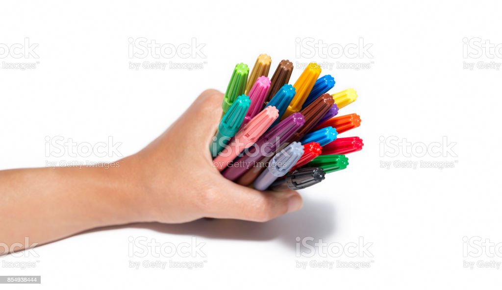 Hand Holding A Pack Of Colorful Markers stock photo