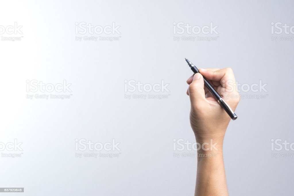 Hand holding a pen for signing or writing stock photo
