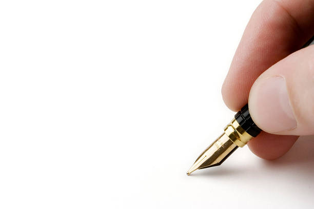 Hand holding a pen isolated over white background stock photo