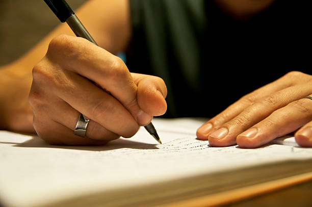 Hand holding a pen writing in a notebook picture id148164620?b=1&k=6&m=148164620&s=612x612&w=0&h= m3w7yqwfmy53a2qtccfsue7uj4pnvhngs cnyqwatw=