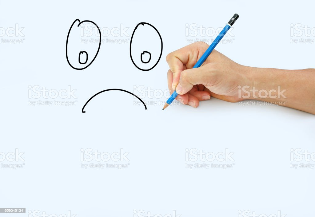 Hand holding a pencil on a white paper background. royalty-free stock photo
