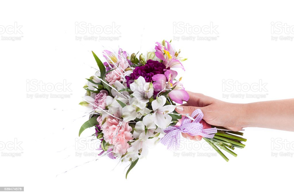 Hand holding a pink bouquet from gillyflowers and alstroemeria o stock photo