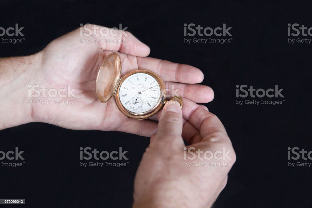 A Hand Holding a Pocket Watch stock photo