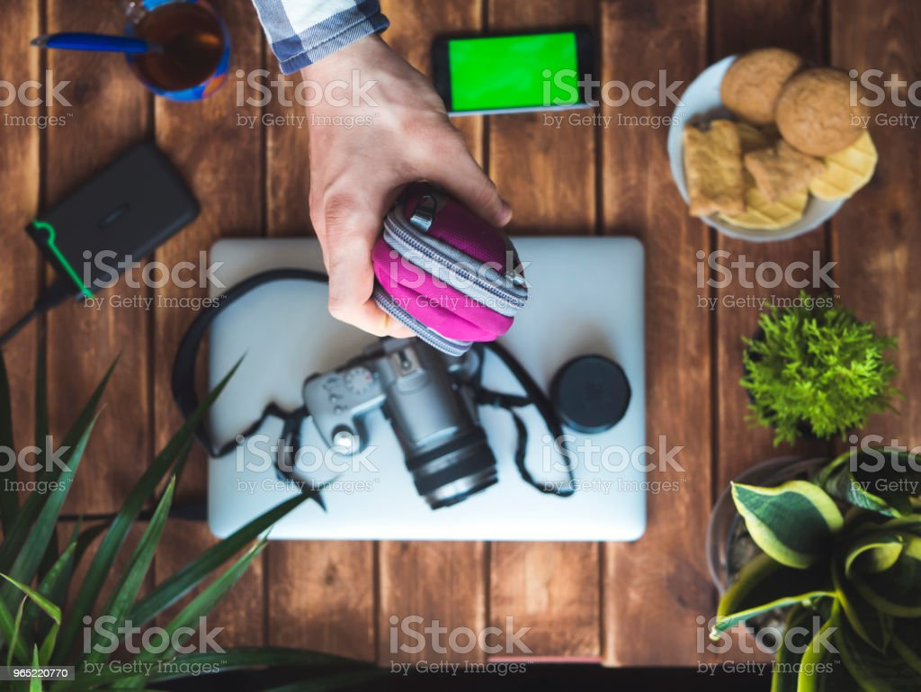 hand holding a protection camera case over wooden table royalty-free stock photo