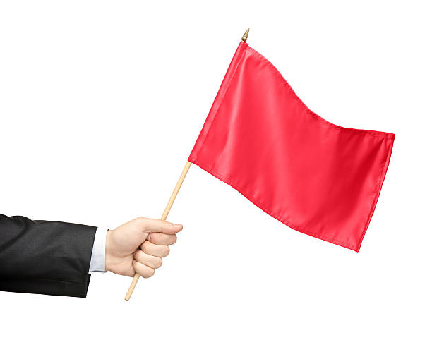 Hand holding a red flag stock photo
