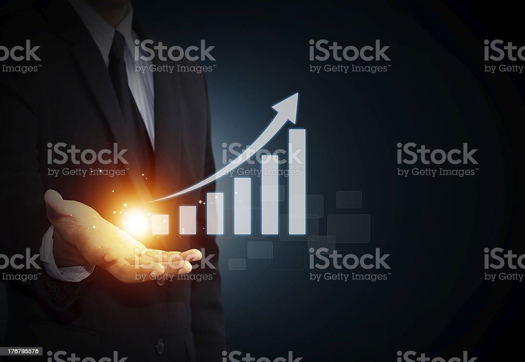 Hand holding a rising arrow royalty-free stock photo