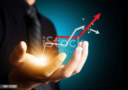istock Hand holding a rising growth arrow 186110382