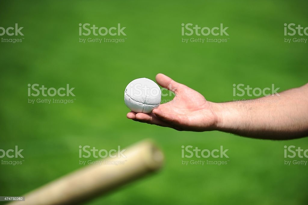 Hand holding a rounders ball stock photo