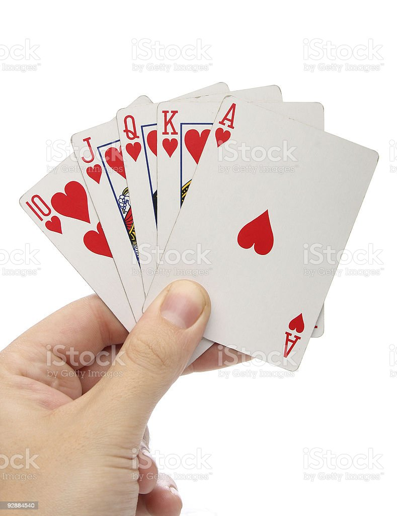 Hand holding a Royal Flush. stock photo