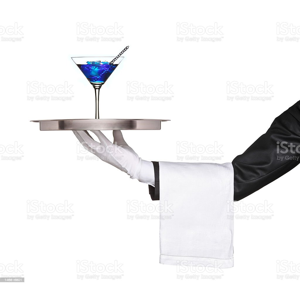 Hand holding a silver tray with blue cocktail on it royalty-free stock photo