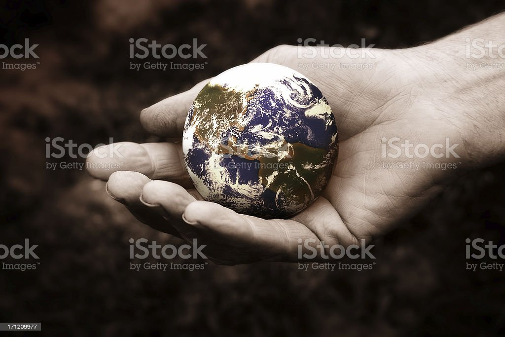 Hand holding a small globe of the world royalty-free stock photo