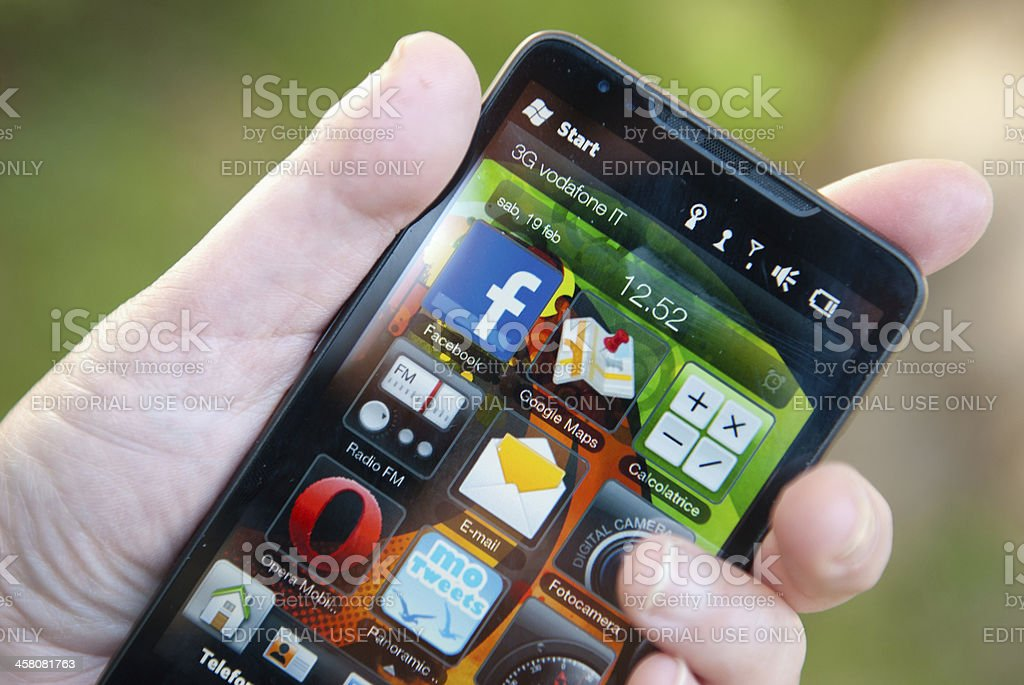 Hand holding a smarthphone with some apps for windows mobile royalty-free stock photo
