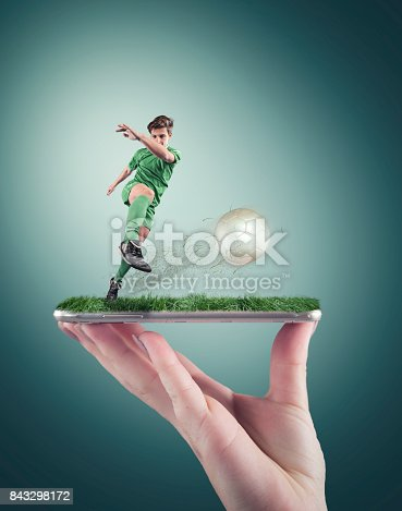 istock Hand holding a smartphone 843298172