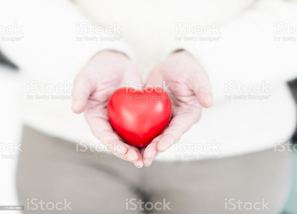 Hand holding a st. valentine gift royalty-free stock photo
