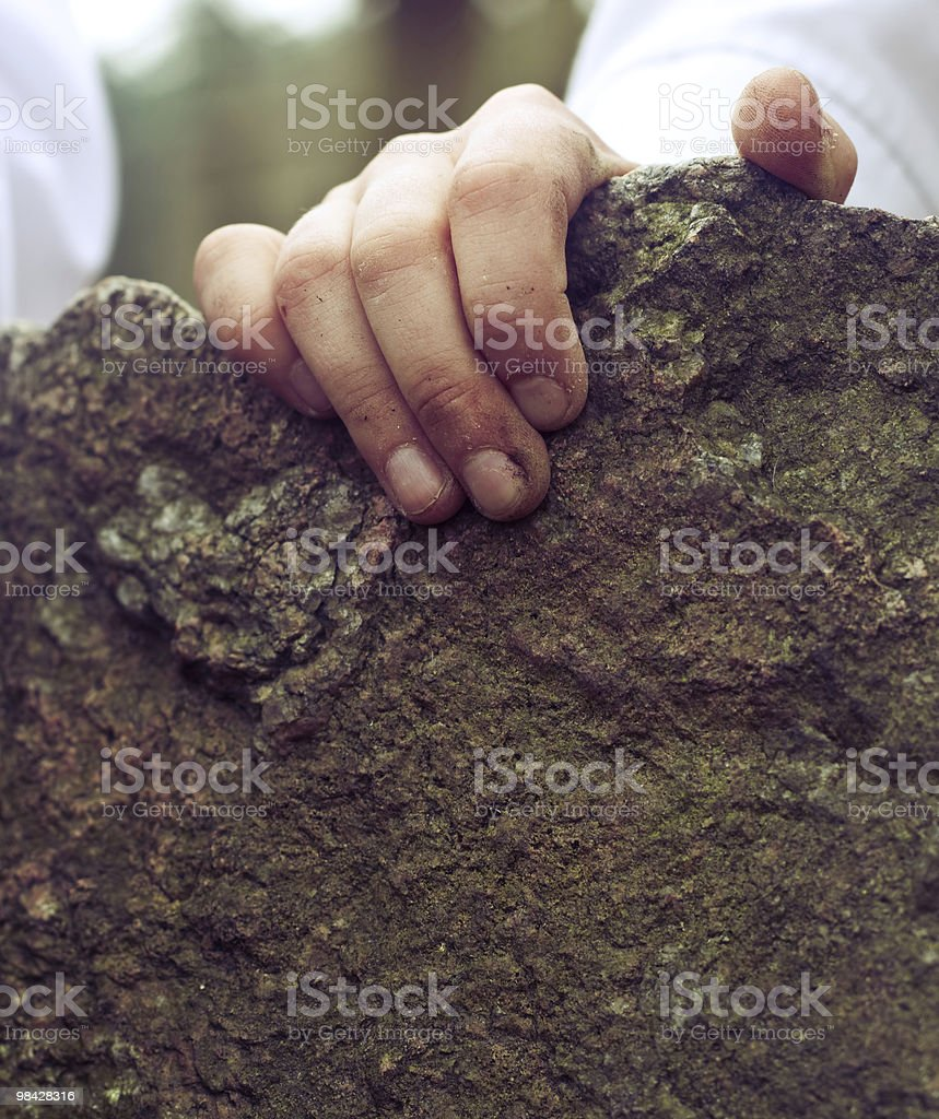 Hand holding a stone royalty-free stock photo