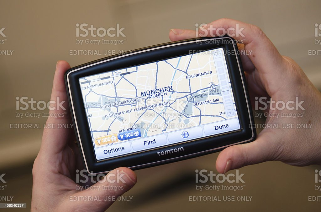 Hand holding a TomTom showing map of Munchen royalty-free stock photo