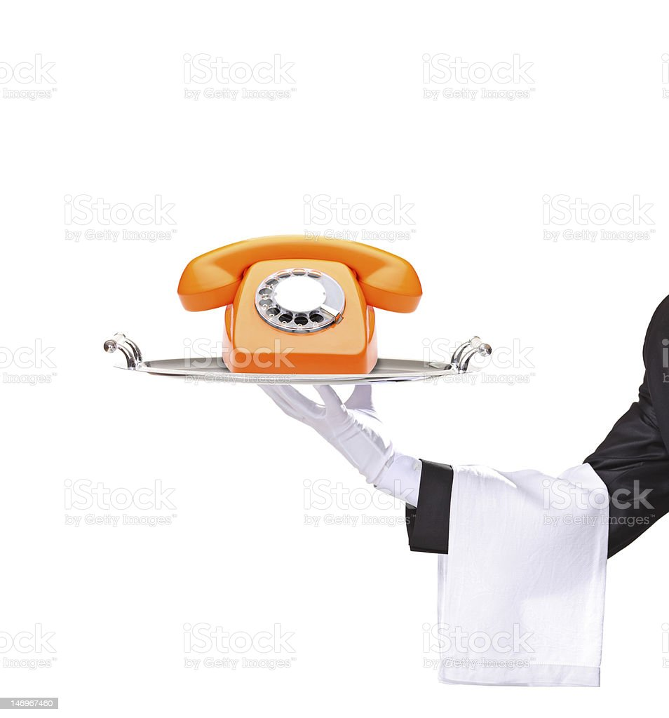 Hand holding a tray with an orange telephone royalty-free stock photo