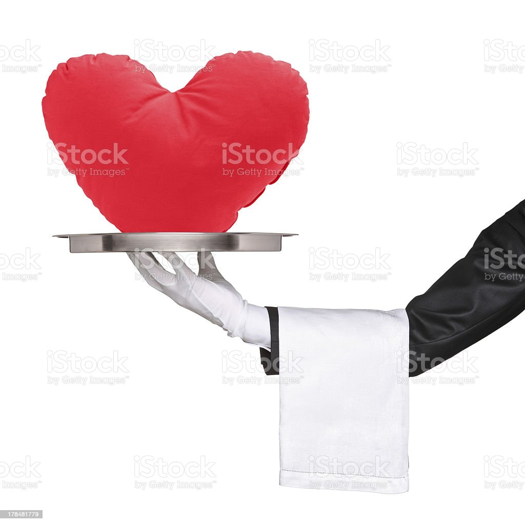 Hand holding a tray with heart shaped objecton it stock photo