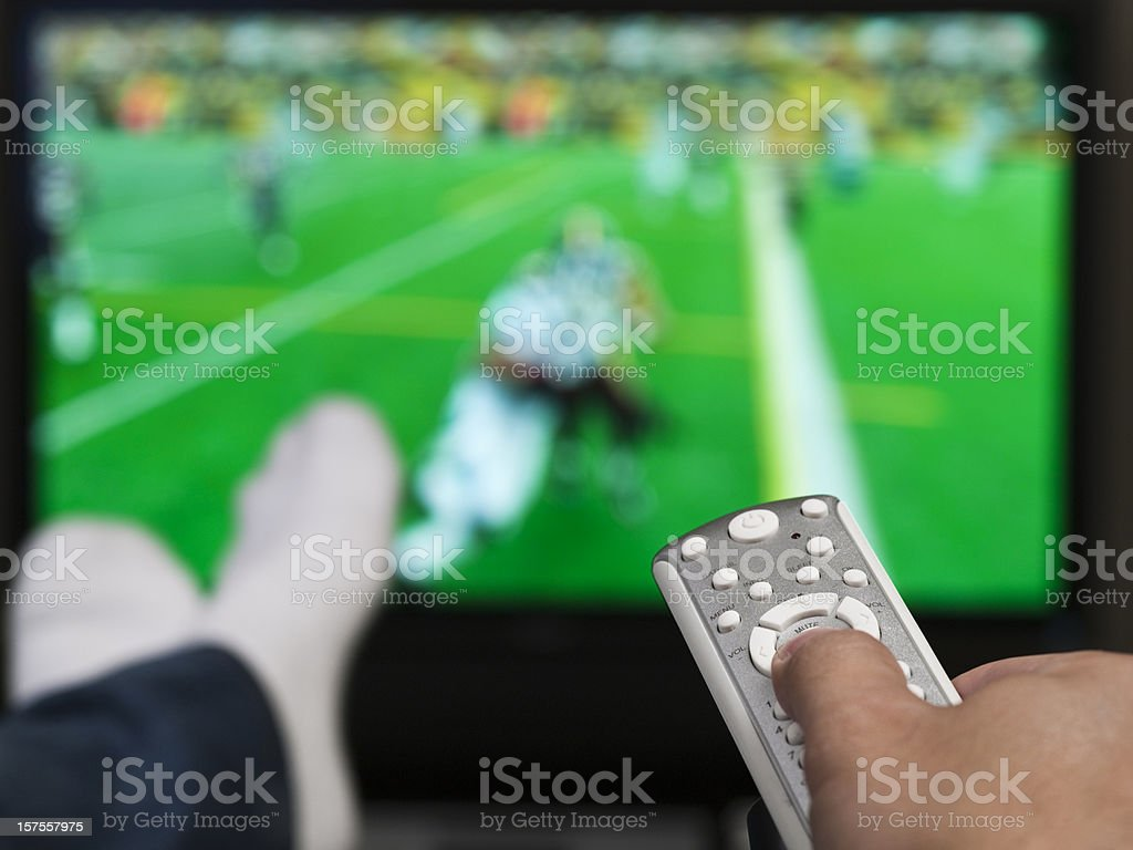 Hand holding a tv remote control royalty-free stock photo