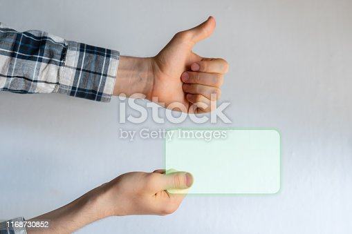 istock hand holding a virtual modern tech visit card, creative concept, mockup copy space 1168730852
