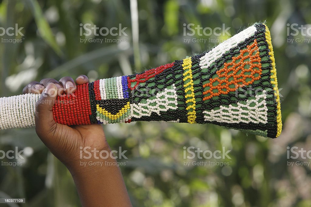 Hand holding a Vuvuzela stock photo