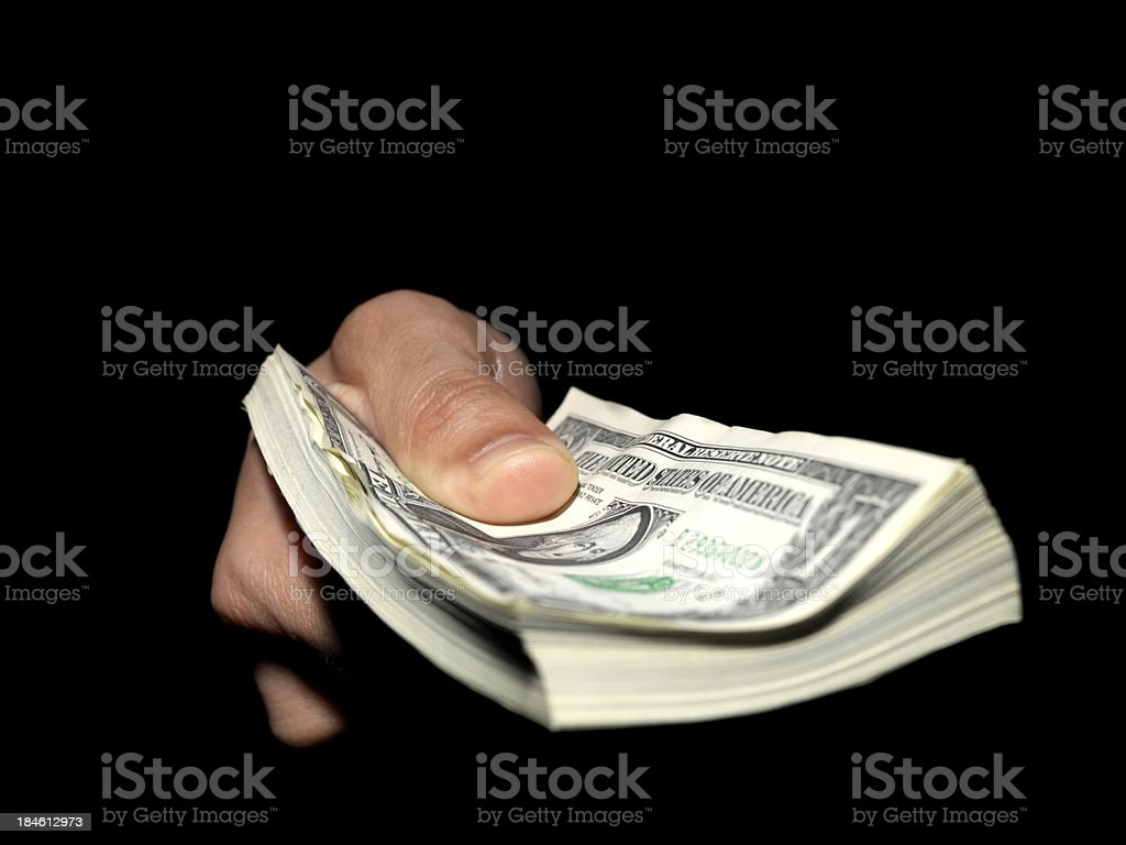 Hand holding a wad of bills stock photo