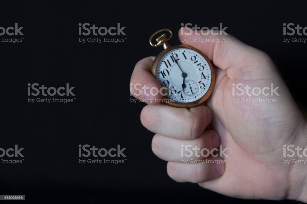 A Hand Holding a Watch stock photo